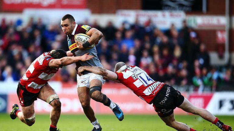 Joe Marchant is tackled by Jacob Rowan and Charlie Sharples