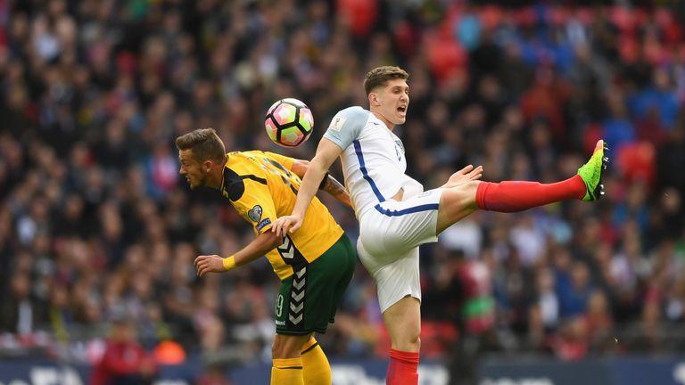England defender John Stones challenges Lithuania's Nerijus Valskis