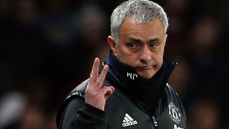 Jose Mourinho holds up three fingers during the Emirates FA Cup Quarter-Final match between Chelsea and Manchester United at Stamford Bridge