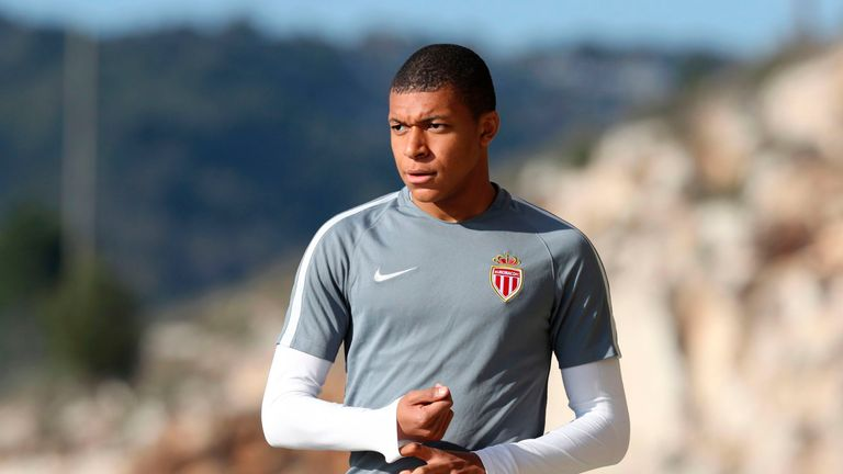 Monaco's French forward Kylian Mbappe Lottin arrives for a training session on the eve of their UEFA Champions League match v Manchester City