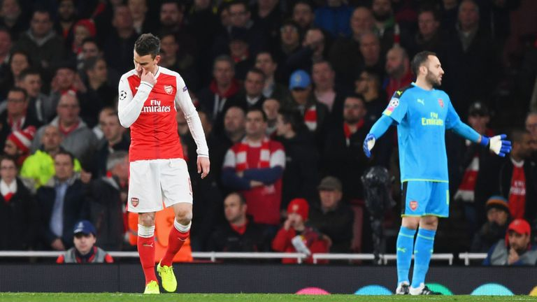 LONDON, ENGLAND - MARCH 07:  Laurent Koscielny of Arsenal looks dejected as he is sent off during the UEFA Champions League Round of 16 second leg match be