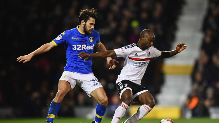LONDON, ENGLAND - MARCH 07:  Sone Aluko of Fulham holds off Alfonso Pedraza of Leeds United during the Sky Bet Championship match between Fulham and Leeds