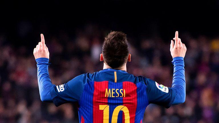Lionel Messi celebrates his second goal against Valencia