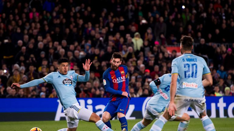 BARCELONA, SPAIN - MARCH 04:  Lionel Messi of FC Barcelona shoots the ball and scores his team's fifth goal