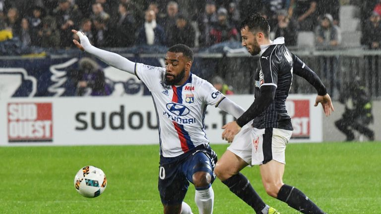 Lyon's French forward Alexandre Lacazette (L) vies for the ball with Bordeaux's Serbian defender Milan Gajic during the French L1 footbal match between Bor