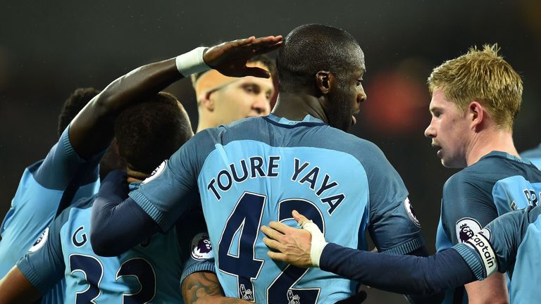 Manchester City's Ivorian midfielder Yaya Toure (C) celebrates scoring his team's fourth goal from the penalty spot during the English Premier League footb