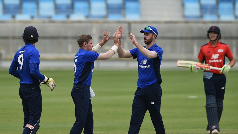 Mason Crane (L)  celebrates with James Vince (R) during this year's North South match in Dubai