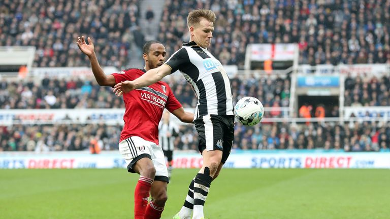 Newcastle United's Matt Ritchie and Fulham's Dennis Odoi during the Sky Bet Championship match at St James' Park, Newcastle.