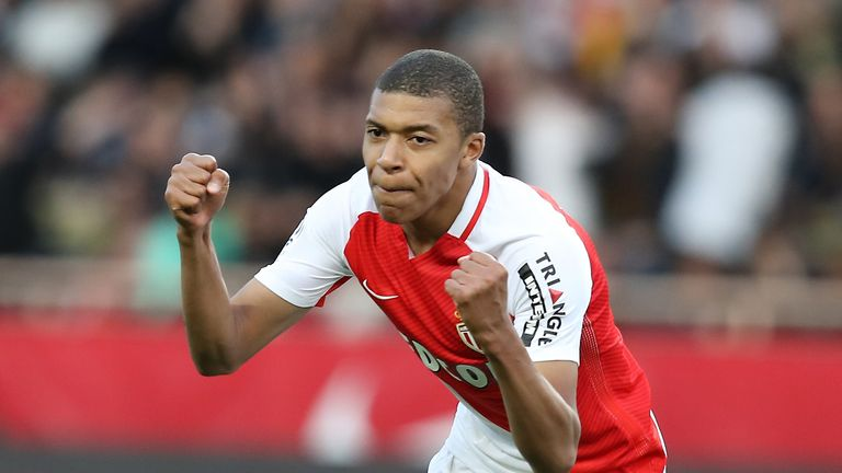 Monaco's French forward Kylian Mbappe celebrates after scoring a goal during the French L1 football match Monaco (ASM) vs Bordeaux (GB)