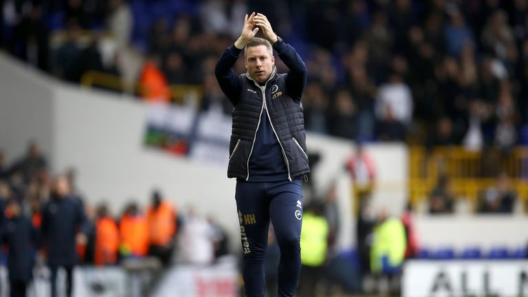 LONDON, ENGLAND - MARCH 12:  Neil Harris, manager of Millwall appluads the travelling fans after defeat in The Emirates FA Cup Quarter-Final match between