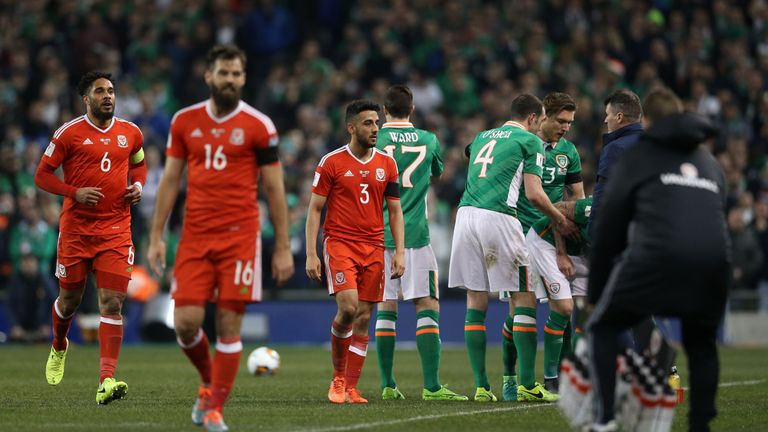 Wales' Neil Taylor (centre) was sent off after breaking Seamus Coleman's leg during a World Cup qualifier