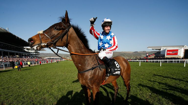CHELTENHAM, ENGLAND - MARCH 15: Noel Fehily riding Special Tiara celebrate winning The Betway Quenn Mother Champion Chase at Cheltenham racecourse on day t