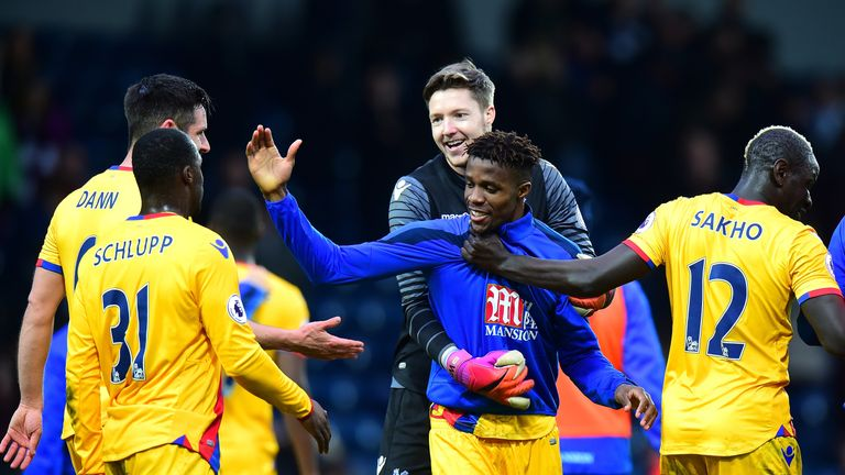 WEST BROMWICH, ENGLAND - MARCH 04: Wilfried Zaha of Crystal Palace (C) celebrates with his Crystal Palace team mates after the Premier League match between