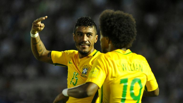 Brazil's midfielder Paulinho (L) celebrates with teammate Brazil's midfielder Willian his second goal during their 2018 FIFA World Cup qualifier football m