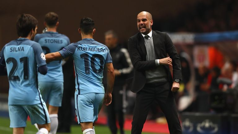Manchester City manager Pep Guardiola speaks to Sergio Aguero