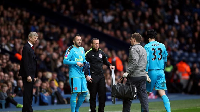 Arsenal goalkeeper David Ospina replaces goalkeeper Petr Cech after he picks up an injury during the Premier League match at The Hawthorns, West Bromwich.