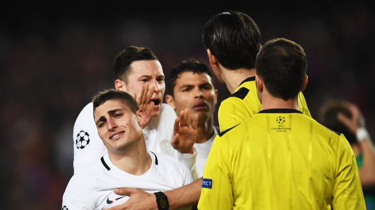 Marco Verratti and Julian Draxler appeal to referee Deniz Aytekin after Barcelona are awarded a penalty