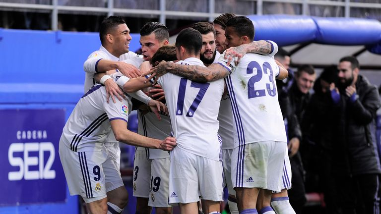 Real Madrid's players celebrate after Karim Benzema scoring their team's first goal during the Spanish league football match Eibar vs Real Madrid