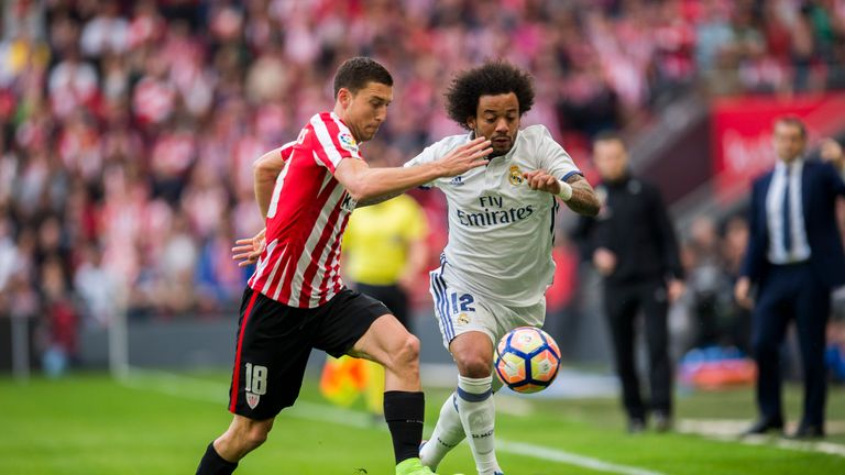 Real defender Marcelo competes for the ball with Bilbao's Oscar De Marcos