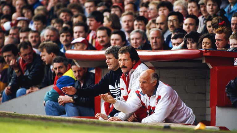 Liverpool manager Graeme Souness (C) with backroom staff Phil Boersma (L) and Ronnie Moran (R) in the Anfield dug out during a match circa 1991