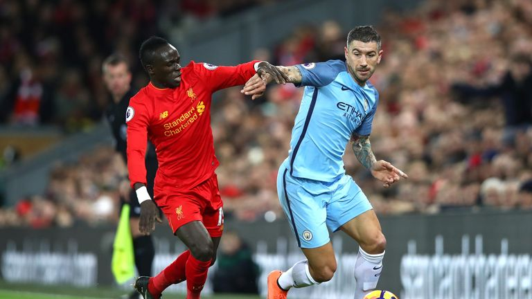 LIVERPOOL, ENGLAND - DECEMBER 31:  Sadio Mane of Liverpool and Aleksander Kolorov of Manchester City clash during the Premier League match between Liverpoo