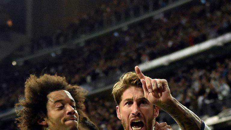 Sergio Ramos celebrates his goal with team-mates during the La Liga match against Real Betis