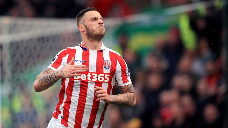 Marko Arnautovic wheels away in celebration after scoring Stoke City's first goal of the game