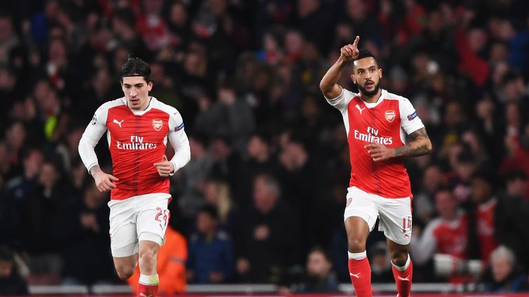LONDON, ENGLAND - MARCH 07:  Theo Walcott of Arsenal (R) celebrates as he scores their first goal with Hector Bellerin during the UEFA Champions League Rou