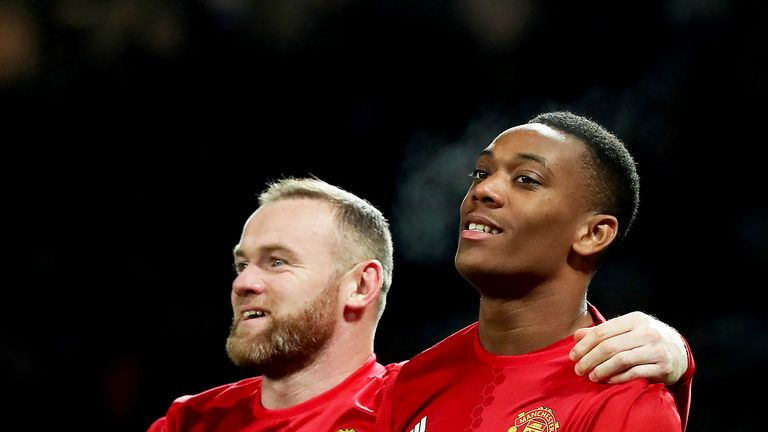 Anthony Martial celebrates scoring Manchester United's second goal of the game with team-mate Wayne Rooney