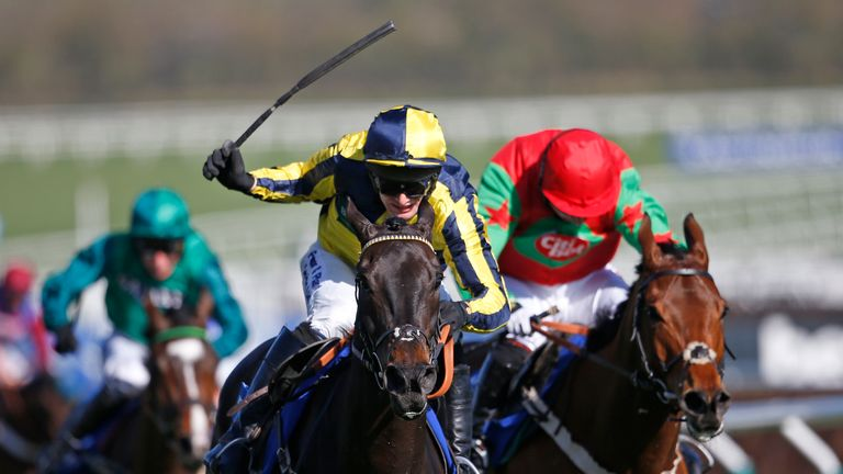 CHELTENHAM, ENGLAND - MARCH 15: David Bass riding Willoughby Court (C) clear the last to win The Neptune Investment Management Novicesâ Hurdle from Neon W