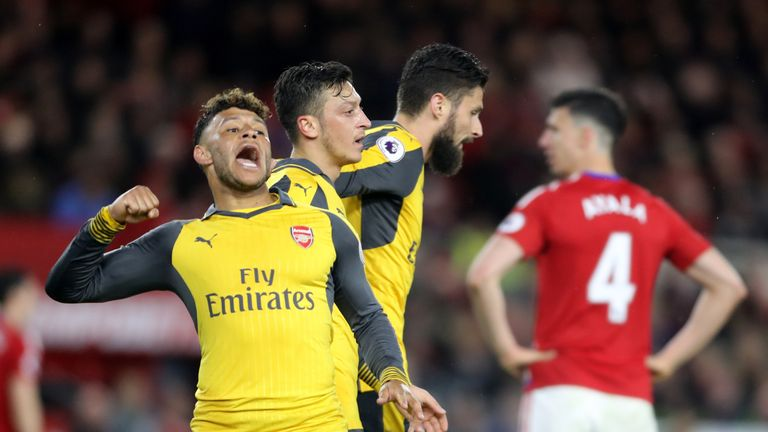 Arsenal's Mesut Ozil (second left)celebrates scoring his side's second goal of the game alongside Alex Oxlade-Chamberlain during the Premier League match a