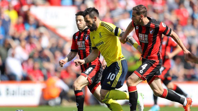 Alvaro Negredo is put under pressure by Harry Arter and Dan Gosling at Bournemouth