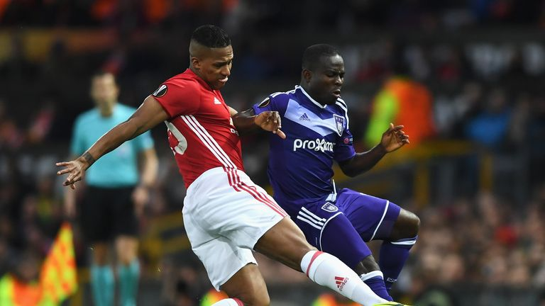 Frank Acheampong of RSC Anderlecht is tackled by Antonio Valencia of Manchester United during the UEFA Europa League quarter final