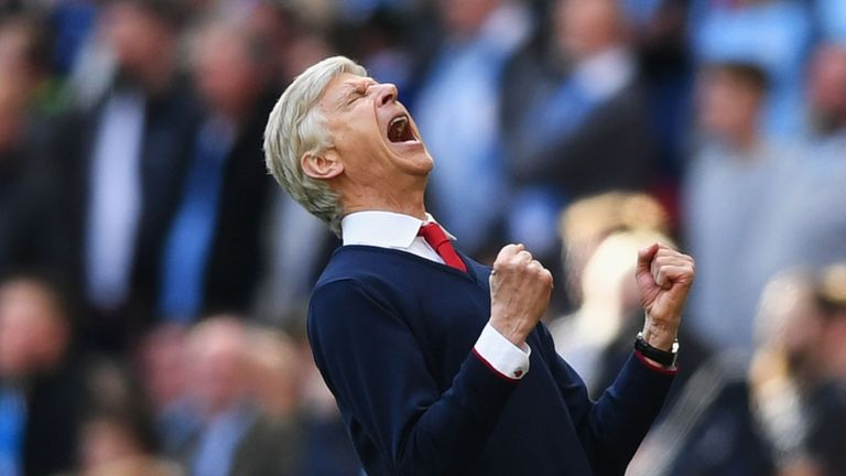 LONDON, ENGLAND - APRIL 23:  Arsene Wenger manager of Arsenal celebrates his team's 2-1 victory at the final whistle during the Emirates FA Cup Semi-Final