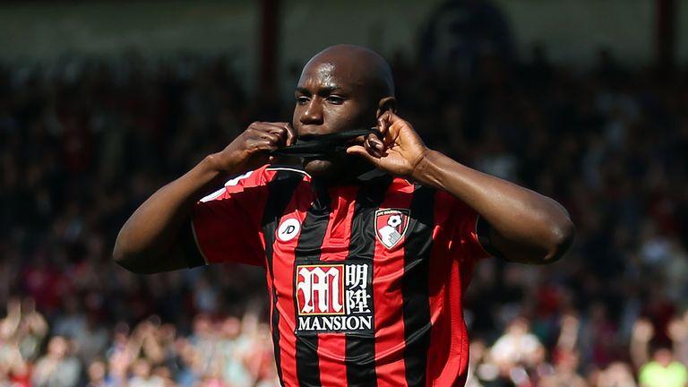 Benik Afobe kisses a black armband in memory of Ugo Ehiogu while celebrating his goal against Middlesbrough