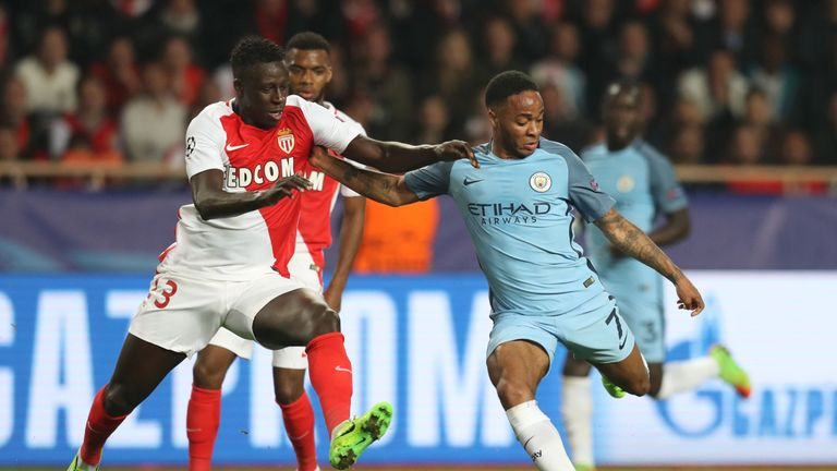Monaco's French defender Benjamin Mendy (L) challenges Manchester City's English midfielder Raheem Sterling during the UEFA Champions League round of 16