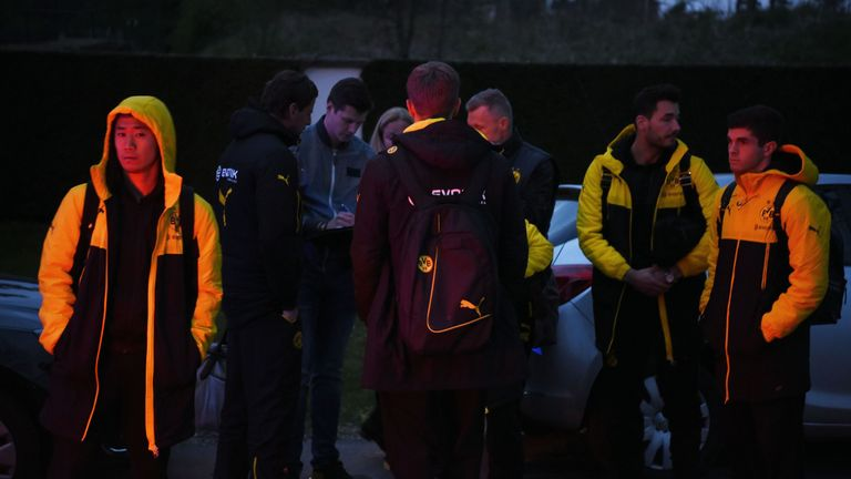 Borrusia Dortmund players wait after their team bus was damaged by three explosions