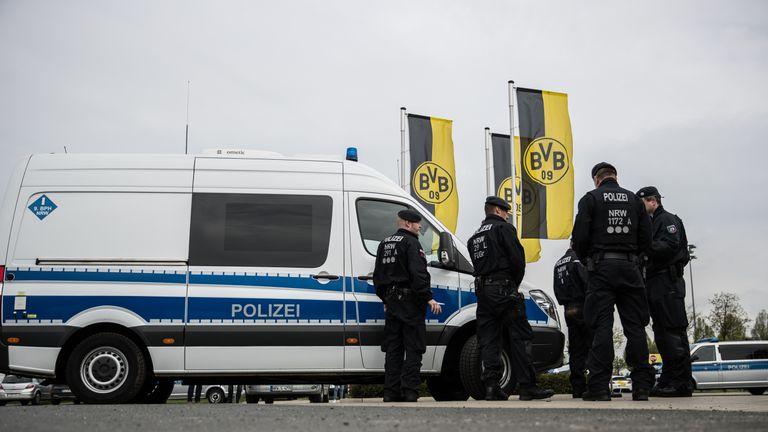 Police stands next to the Dortmund Brackel Training Ground of Borussia Dortmund prior to the UEFA Champions League Quarter Final v Monaco