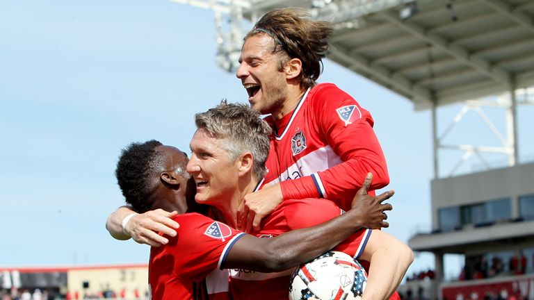 astian Schweinsteiger #31 of Chicago Fire is congratulated by David Accam #11 and Joao Meira #66 after scoring a goal in the fi