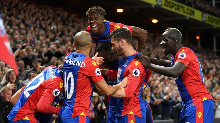LONDON, ENGLAND - APRIL 10:  Yohan Cabaye of Crystal Palace (obscured) is mobbed by team mates as he celebrates scoring their second goal during the Premie