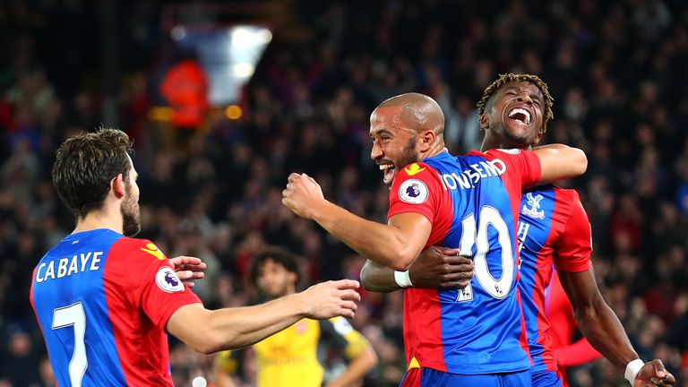 Andros Townsend of Crystal Palace (10) celebrates with Wilfried Zaha and Yohan Cabaye as he scores their first goal