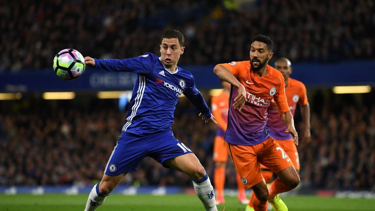 Eden Hazard of Chelsea (L) and Gael Clichy of Manchester City (R) battle for possession during the Premier League match