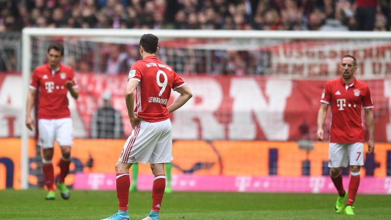 MUNICH, GERMANY - APRIL 22: Robert Lewandowski of Bayern Muenchen reacts after the second goal of FSV Mainz 05 during the Bundesliga match between Bayern M