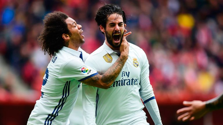 Isco celebrates his winning goal with team-mate Marcelo