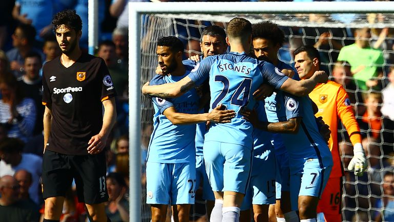 Manchester City celebrate their opening goal against Hull