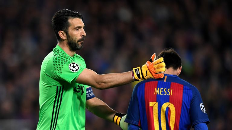 BARCELONA, SPAIN - APRIL 19:  Gianluigi Buffon ofJuventus pats Lionel Messi of Barcelona on the back during the UEFA Champions League Quarter Final second