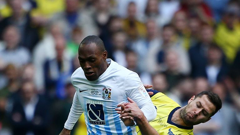 Coventry's Kyle Reid holds off Oxford United's Phil Edwards during the EFL Checkatrade Trophy Final