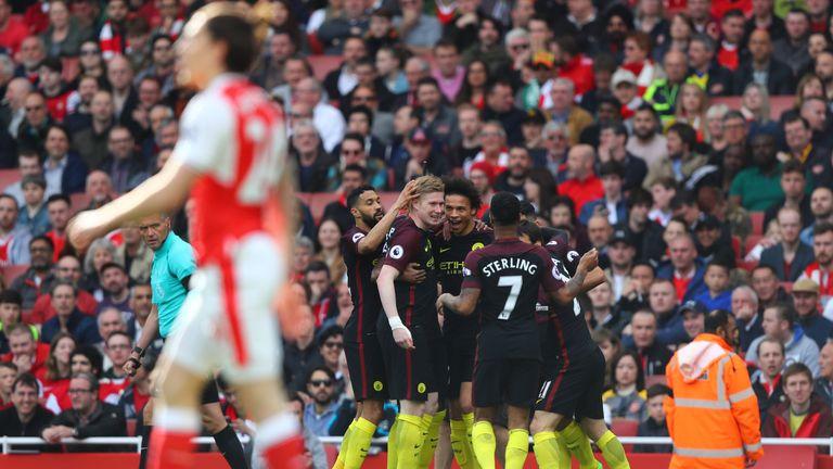 LONDON, ENGLAND - APRIL 02: Leroy Sane of Manchester City celebrates scoring his sides first goal with his Manchester City team mates during the Premier Le