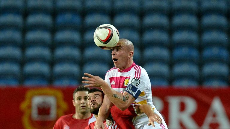 Scotland's Scott Brown battles for the ball with Gibraltar's Liam Walker, during the European Championship Qualifying match at the Estadio Algarve, Faro, P