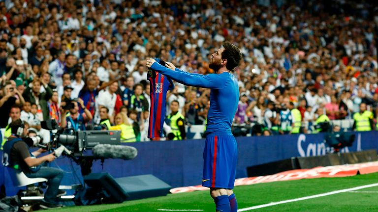 Barcelona's Argentinian forward Lionel Messi celebrates after scoring during the Spanish league Clasico football match Real Madrid CF vs FC Barcelona at th